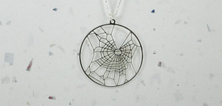 Illustration for article titled Hidden in This Beautiful Jewelry is a Secret Drug-Science Reference