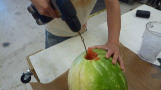 Illustration for article titled Make Watermelon Juice Using a Drill and Coat Hanger