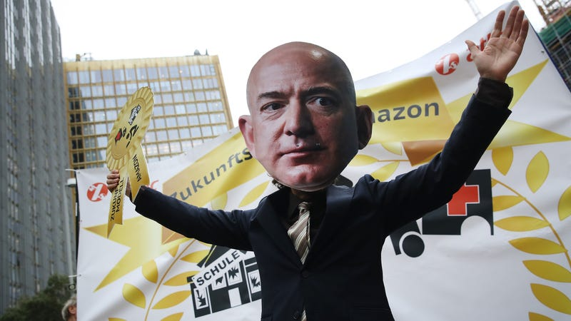 An activist dressed as Amazon CEO Jeff Bezos joins a protest gathering outside the Axel Springer building on April 24, 2018 in Berlin, Germany.
