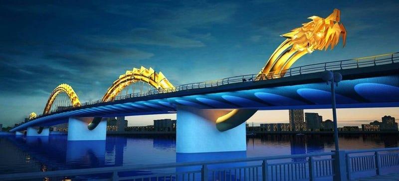 Illustration for article titled Vietnam inaugura un gigantesco puente-dragón que escupe bolas de fuego