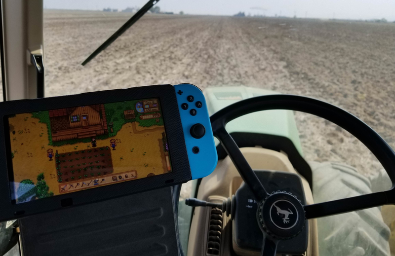 Tim takes his Switch out with him in the tractor to help pass the time during the planting season.