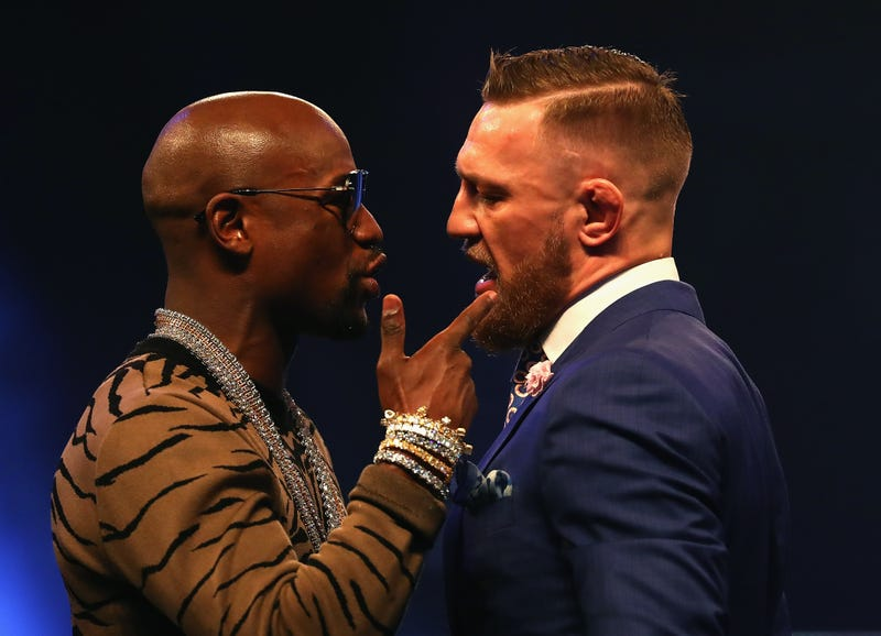 Floyd Mayweather Jr. and Conor McGregor come face-to-face during the Floyd Mayweather Jr. vs. Conor McGregor World Press Tour at SSE Arena on July 14, 2017, in London. (Matthew Lewis/Getty Images)