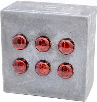 Illustration for article titled Concrete Nixie Clock Tells Time, Requires a Sturdy Table