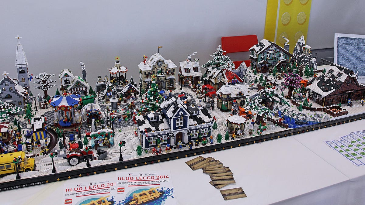 This Winter Village Style Train Station Adds To An Impressive Display