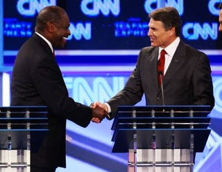 "Herman Cain admonishes Rick Perry over ""Niggerhead."" (Getty)"
