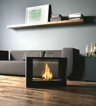 Illustration for article titled Bring Romantic Business Time Anywhere with Portable Conmoto Suitcase Fireplace