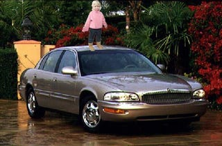 Illustration for article titled Granny Arrested For Driving Around With Kid On Roof Of Car