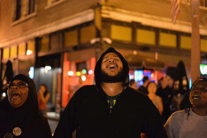 Demonstrators chant during a protest action through the Central West End of St. Louis on Aug. 20, 2015. After a night of unrest sparked by a police-involved shooting, demonstrators took to the streets in actions of civil disobedience. Michael B. Thomas/Getty Images