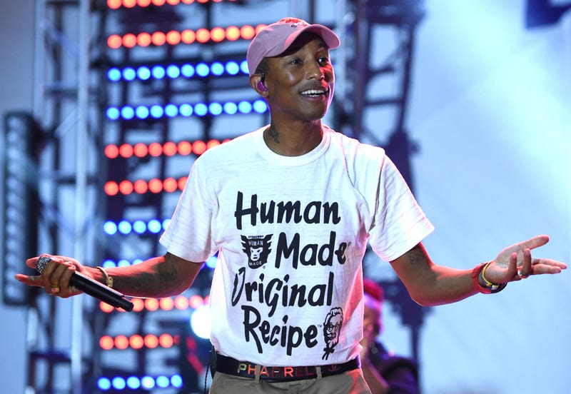 Illustration for article titled Clap Your Hands: Pharrell Williams Makes 114 Grads of Harlem High School 'Happy' With Guaranteed Internships