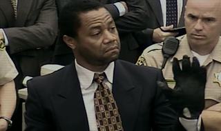 Cuba Gooding Jr. as O.J. Simpson trying on the gloves in The People v. O.J. SimpsonFX screenshot