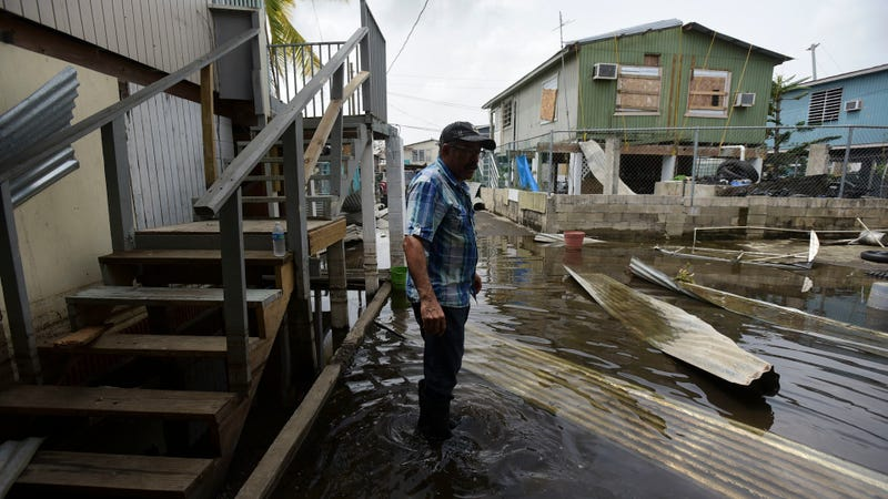 A resident walks through a flooded area of Puerto Rico on Wednesday, Sept. 27. Photo credit: AP Photo/Carlos Giusti