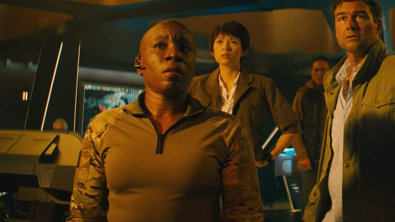 Aisha Hinds, left, Ziyi Zhang, Ken Watanabe and Kyle Chandler in Godzilla: King of the Monsters