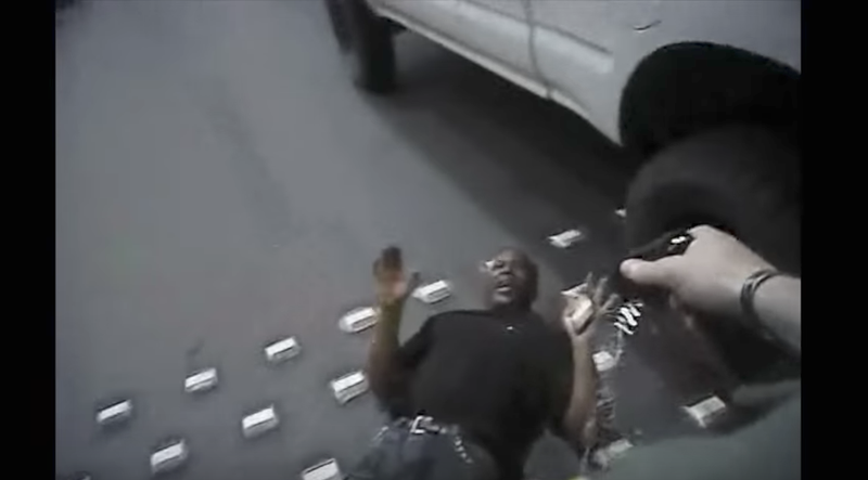 Tashii Brown is seen with his hands in the air as Las Vegas Police Officer Kenneth Lopera deploys his Taser. (Las Vegas Metropolitan Police Department via YouTube screenshot)