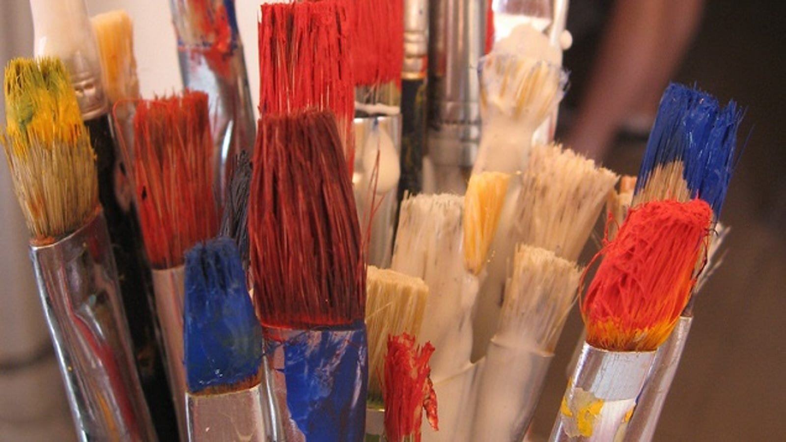 Clean Paint Brushes by Soaking Them In Warm Water with a ...