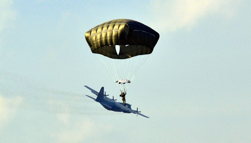Illustration for article titled Cool photo of a paratrooper makes it look like he's surfing an airplane