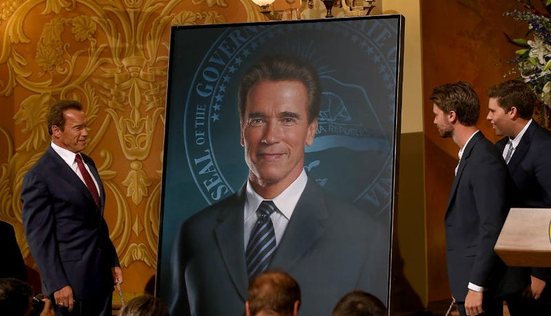 Illustration for article titled Caption This Pic of Arnold Schwarzenegger Gazing At His New Portrait