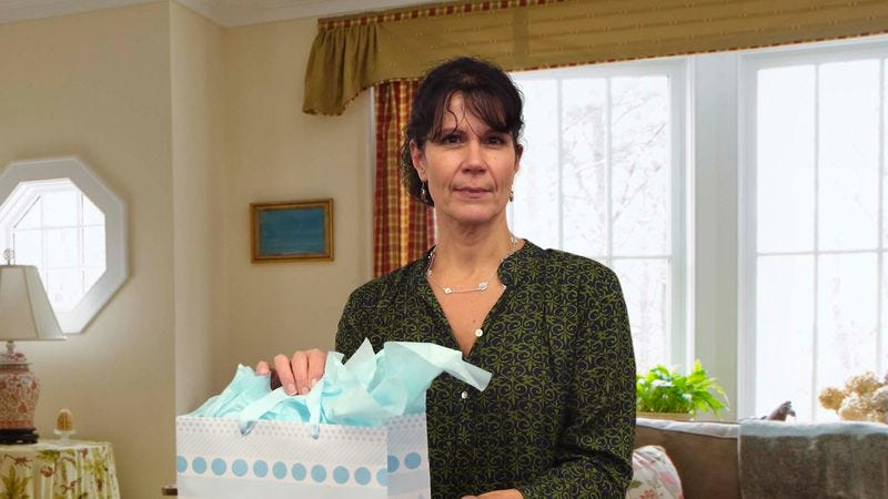 Illustration for article titled Mom Produces Decorative Gift Bag Out Of Thin Air
