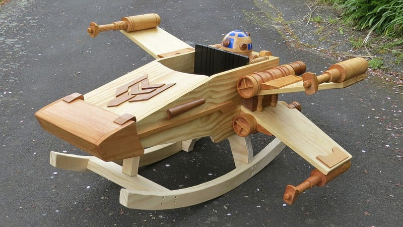 Illustration for article titled This Exquisite Wooden X-wing Rocker Will Make You Miss Being a Kid