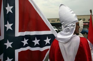 With the Confederate battle flag prominently displayed, members of the Fraternal White Knights of the Ku Klux Klan participate in the 11th Annual Nathan Bedford Forrest Birthday March on July 11, 2009, in Pulaski, Tenn. Forrest was a senior officer in the Confederate Army during the American Civil War.Spencer Platt/Getty Images