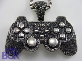 Illustration for article titled Geek Couture: PS2 Inspired Bling Edition