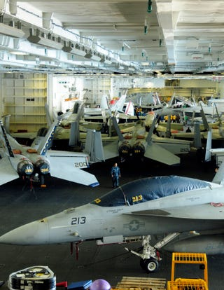 Illustration for article titled This Is the Hangar Bay of a US Navy Aircraft Supercarrier