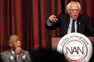 Democratic presidential candidate Sen. Bernie Sanders speaks as the Rev. Al Sharpton looks on during the 25th annual National Action Network convention April 14, 2016, in New York City. Democratic candidate Hillary Clinton spoke April 13 to the group, which raises national issues of importance to black Americans. Clinton and Sanders will meet for a debate in Brooklyn, N.Y., the evening of April 14.Spencer Platt/Getty Images