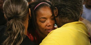 Semehca Nunn, grandmother of the injured 3-month-old boy, is comforted after a prayer service. (Scott Olson/Getty Images)