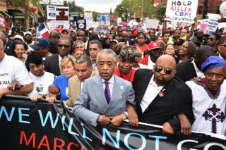The Rev. Al Sharpton marches with protesters at a rally against police brutality in memory of Eric Garner Aug. 23, 2014, in the New York City borough of Staten Island.  Stan Honda/AFP/Getty Images