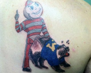 Illustration for article titled This Buckeyes Fan Deemed It Wise To Get An Anal-Rape Themed Tattoo