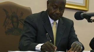 Uganda's President Yoweri Museveni signs the Anti-Homosexuality bill on February 24, 2014 in Entebbe.ISAAC KASAMANI/AFP/Getty Images