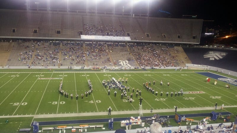 """Illustration for article titled The Rice Marching Band Took Some Halftime Shots At """"U$C"""""""