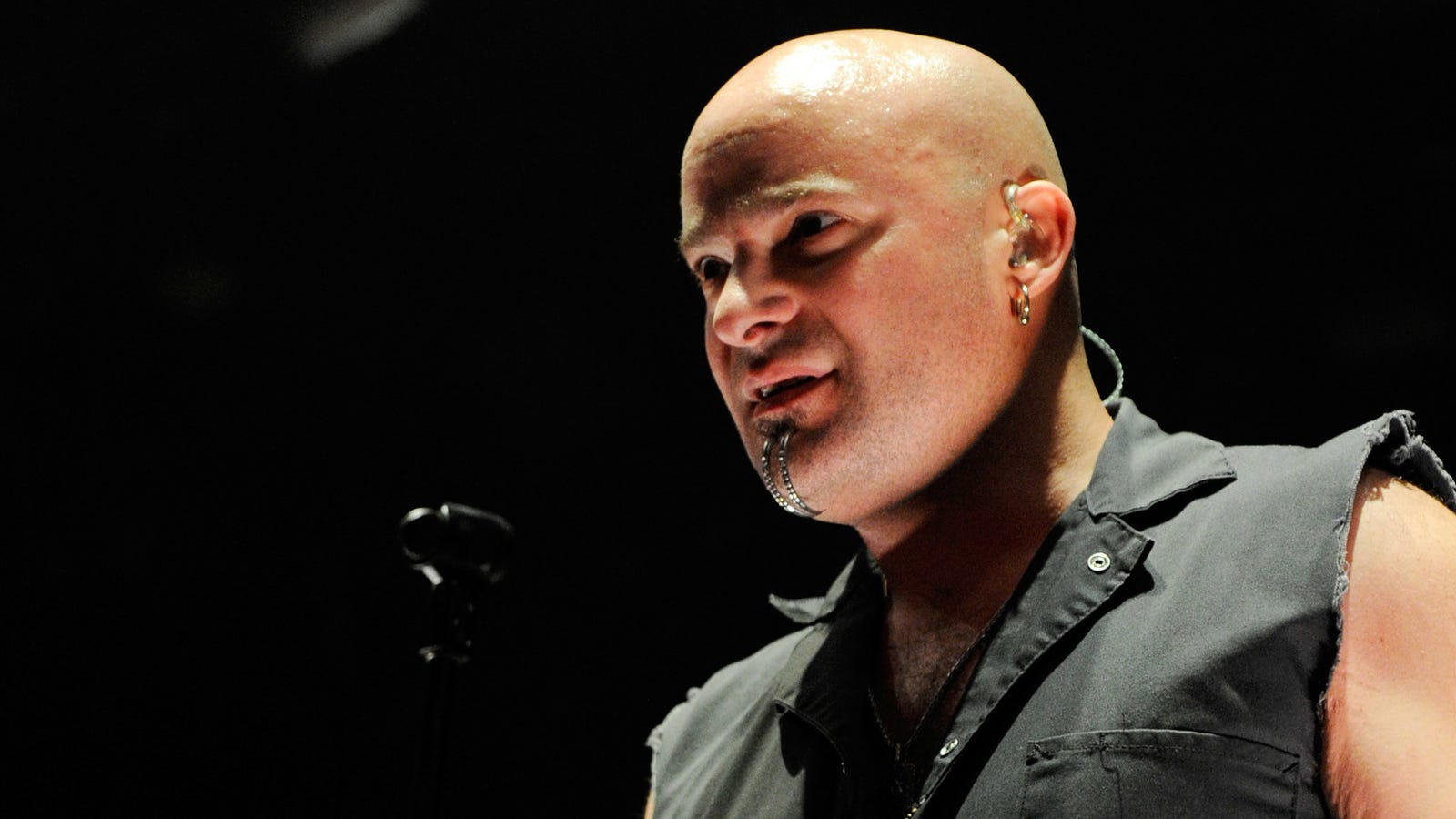 Disturbed singer David Draiman just realized that his chin piercings look a little silly