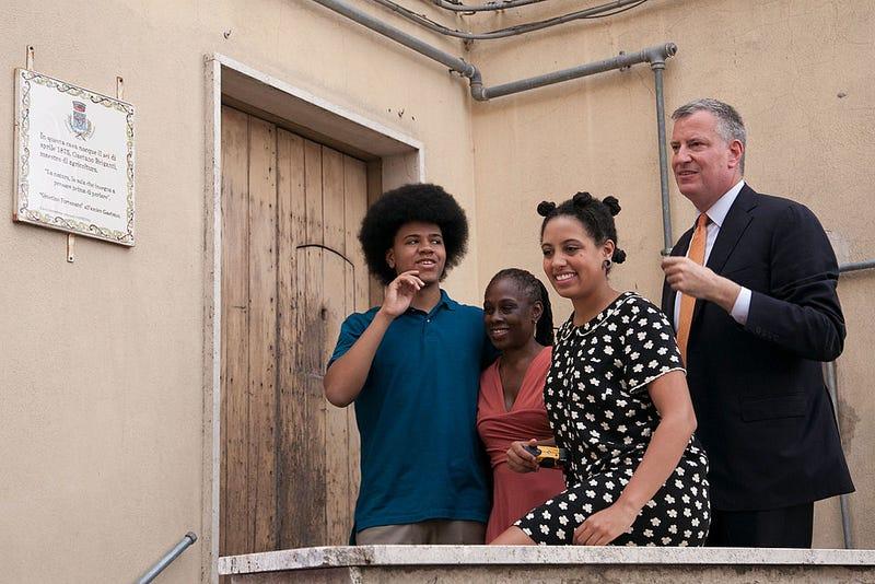 New York City Mayor Bill de Blasio (R), Chirlane McCray (2L), Chiara de Blasio (2R) and Dante de Blasio (L) visit the house his grandmother was born in during a visit to Mayor de Blasio's grandmother's town on July 24, 2014, in Grassano, Italy.
