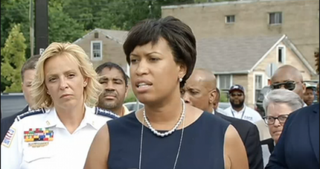 D.C. Mayor Muriel Bowser, center, and Police Chief Cathy Lanier appeal to the public for help in apprehending the killer of reporter Charnice MiltonNBC 4 Washington Screenshot