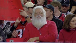 Illustration for article titled Santa Wears Ralph Lauren, Seems Uncomfortable Sitting Among Riffraff Falcons Fans