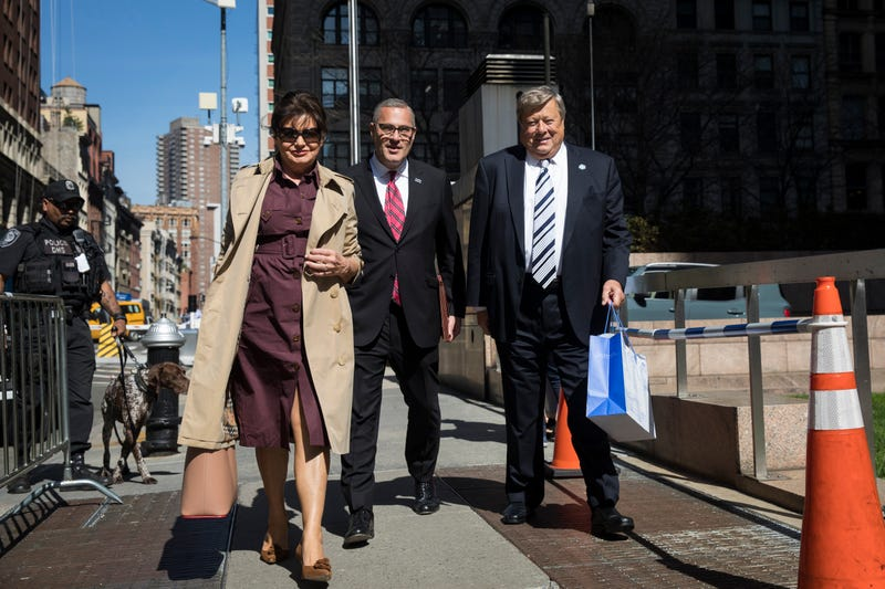 Amalija and Viktor Knavs, parents of U.S. First Lady Melania Trump, arrive with their lawyer Michael Wildes (C) at U.S. Citizenship and Immigration Services at the Jacob K. Javits Federal Building, May 2, 2018 in New York City.