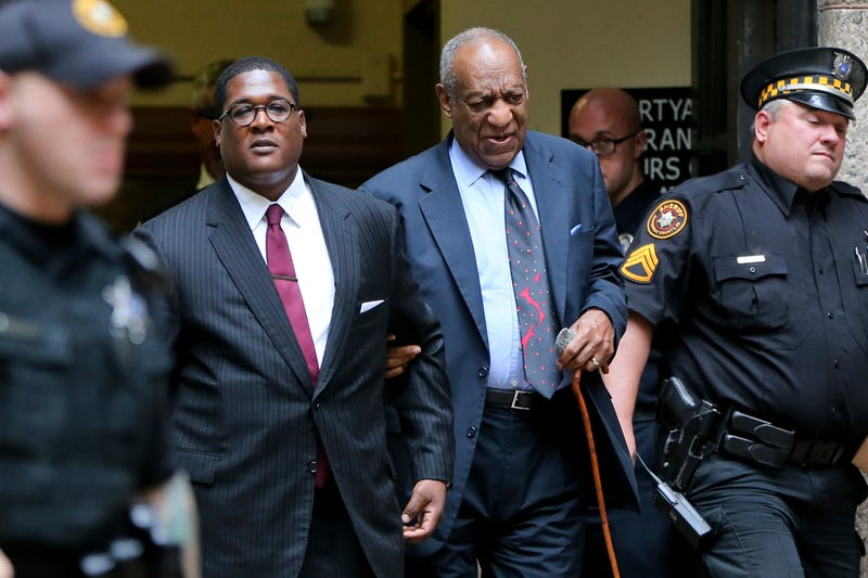 Bill Cosby (second from right) leaves with his publicist Andrew Wyatt at the Allegheny County Courthouse in Pittsburgh on May 24, 2017, after the third day of jury selection in his sexual assault case. The case is set for trial June 5. (Keith Srakocic/AP Images)