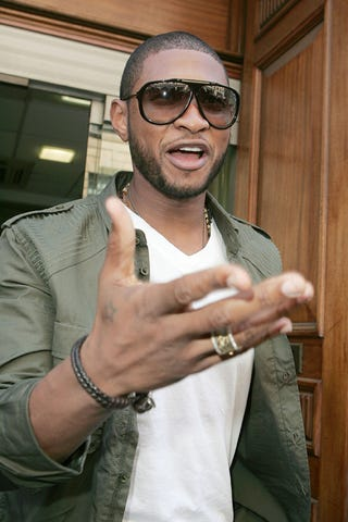 Illustration for article titled Usher Reminds You Of His Star Status With Subtle Tattoo