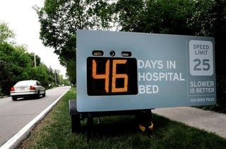 Illustration for article titled Speed Limit Sign Displays Days In Hospital Based On Your Car Speed