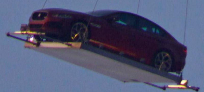 Illustration for article titled The Jaguar XE Got Photographed While Being Airlifted To Its Premier