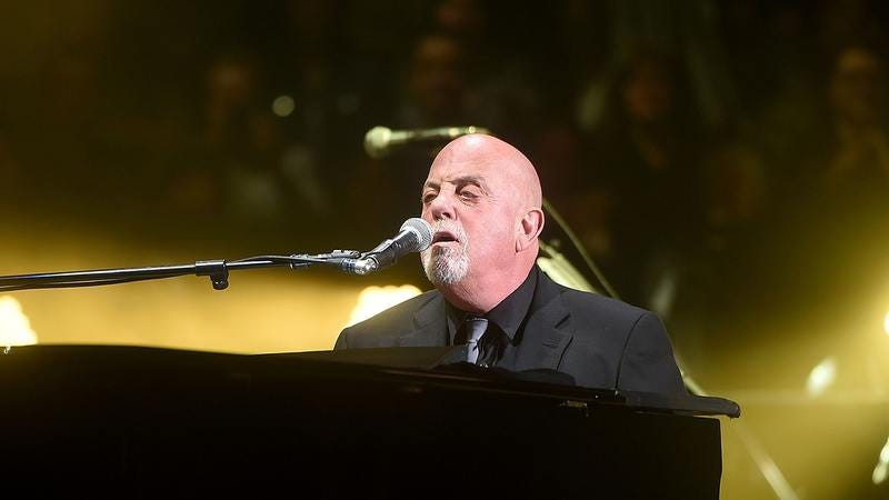 Billy Joel playing piano.