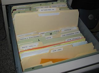 Illustration for article titled Filing Cabinet Tip:  Bookmark where to return a file
