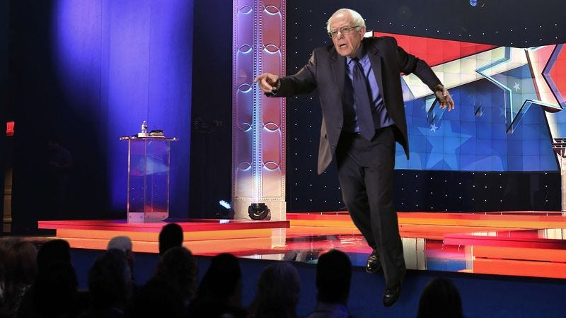 Illustration for article titled Out-Of-Control Hand Gesture Sends Bernie Sanders Tumbling Off Stage