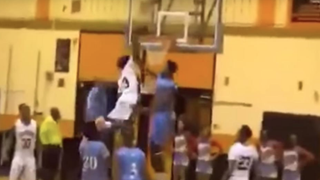 Melvin Lee dunks over two defenders. YouTube screenshot