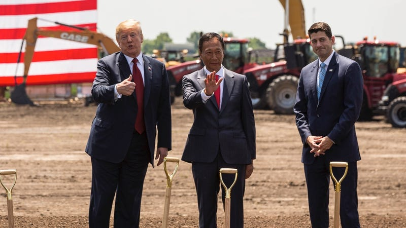 The President of the United States standing like a normal human being (left) with Foxconn CEO Terry Gou (center) and Paul Ryan (right) on June 28, 2018