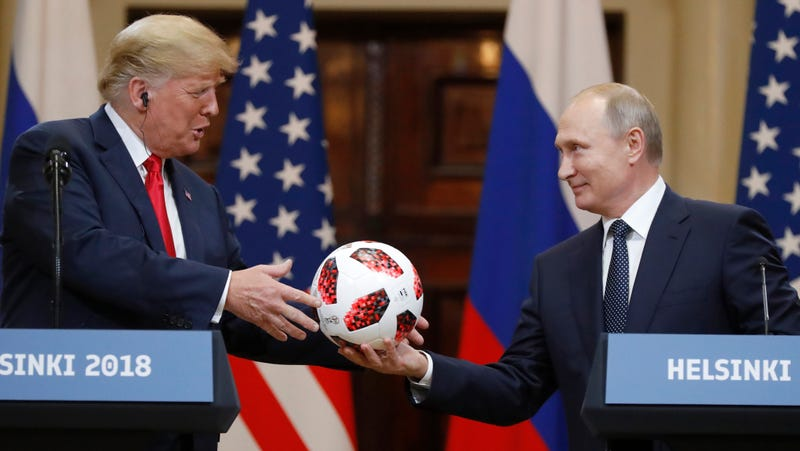 Putin gives Trump a soccer ball at a conference in Helsinki, Finland this week.