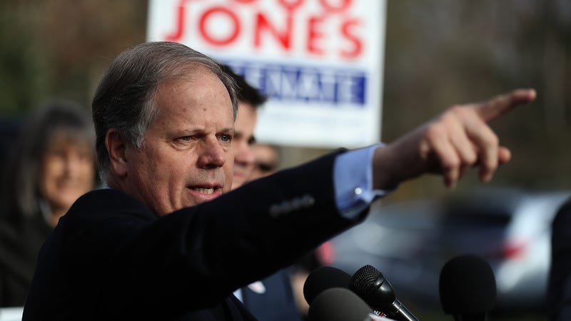 Then-Democratic senatorial candidate Doug Jones speaks to reporters after voting at Brookwood Baptist Church in Mountain Brook, Ala., on Dec. 12, 2017. (Justin Sullivan/Getty Images)