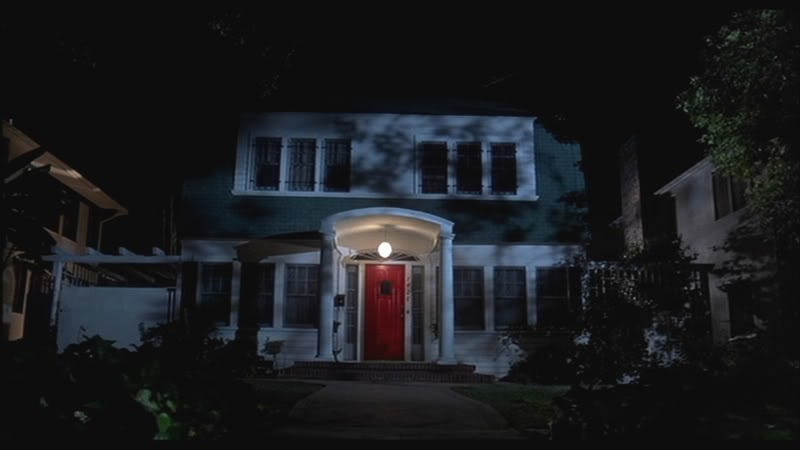 Another red door in a movie where people die while in an altered reality (Image: Nightmare on Elm Street, New Line Cinema)