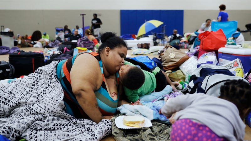 Florida residents hunkering down in Miami in one of the state's 320 shelters. Image via the AP.