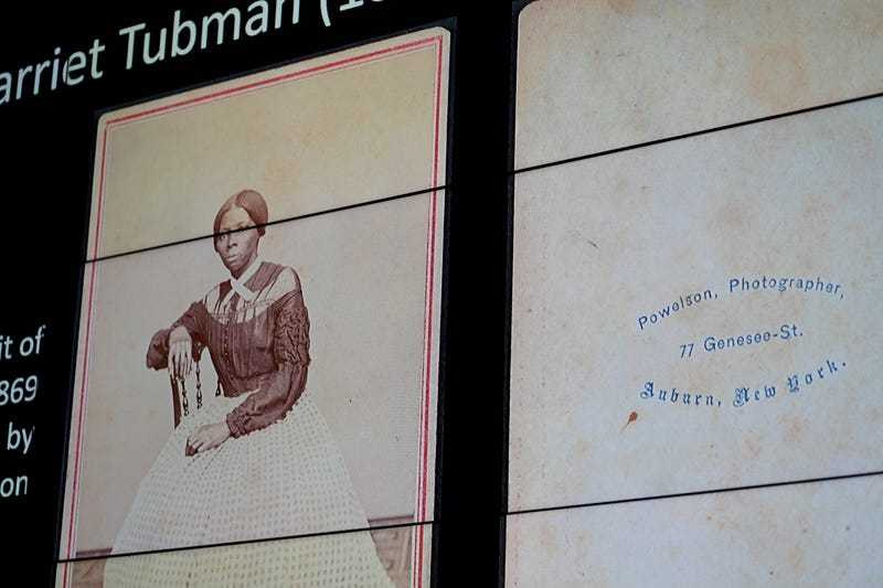 A previously unknown portrait, c. 1868, of abolitionist and Underground Railroad conductor Harriet Tubman is projected on a screen before the unveiling of the photograph at The Smithsonian's National Museum of African American History and Culture in Washington, on March 25, 2019.